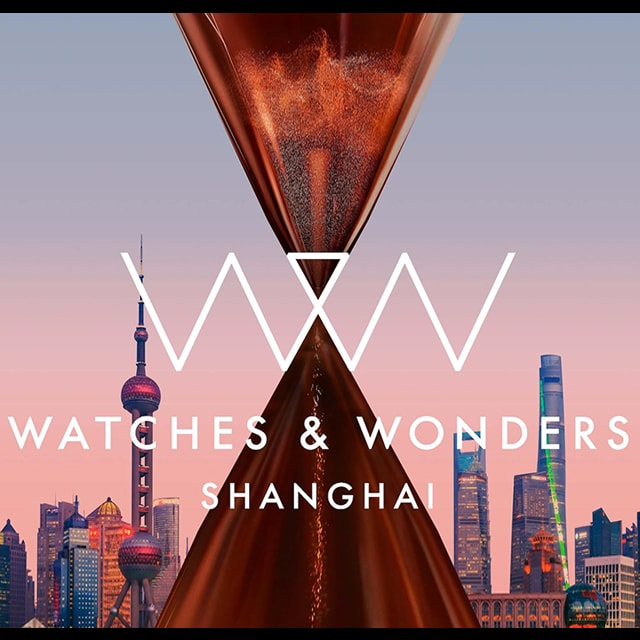 Logo of Watches and Wonders against the backdrop of Shanghai city with pink evening glow